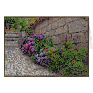 Hydrangeas and geraniums on cobblestone street card