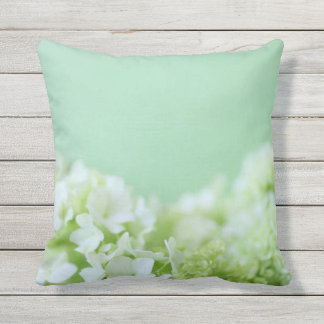 Hydrangeas on green background throw pillow