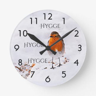 Hygge with a cute Robin bird in snow Round Clock