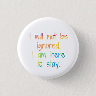 I am here to stay. 1 inch round button