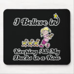 i believe in keeping all ducks in a row mouse pad