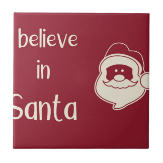 I believe in Santa words. Red background. Tile
