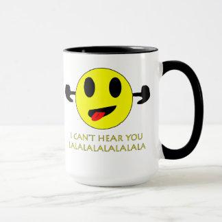 i can't hear you, ears plugged smiley mug