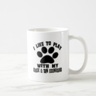 I like to play with my Black & Tan Coonhound. Mugs