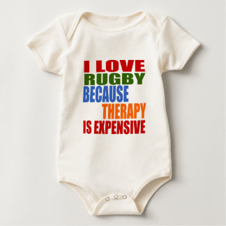 I LOVE RUGBY  BECAUSE THERAPY IS EXPENSIVE BABY BODYSUIT