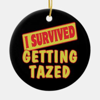 I SURVIVED GETTING TAZED ROUND CERAMIC ORNAMENT