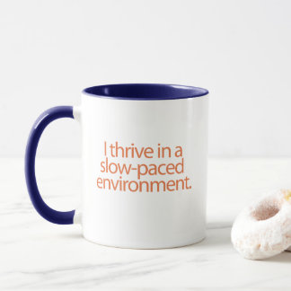 I thrive in a slow-paced environment. mug