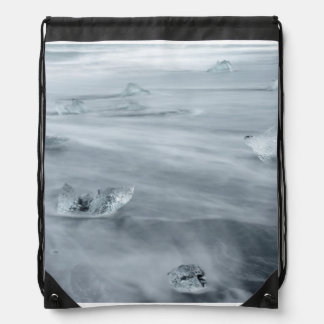 Ice and water on a beach, iceland drawstring bag