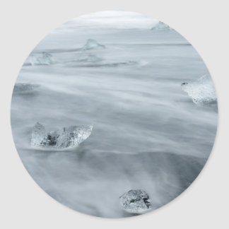 Ice and water on a beach, iceland round sticker
