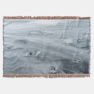 Ice and water on a beach, iceland throw blanket