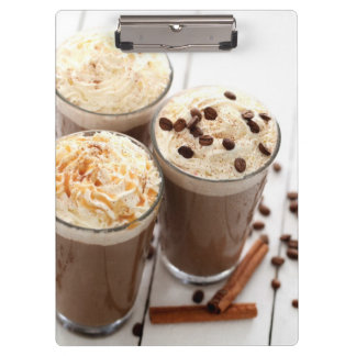 Ice coffee with whipped cream and coffee beans clipboard