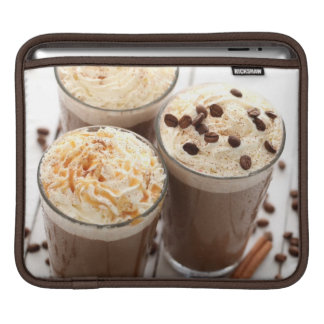Ice coffee with whipped cream and coffee beans sleeve for iPads