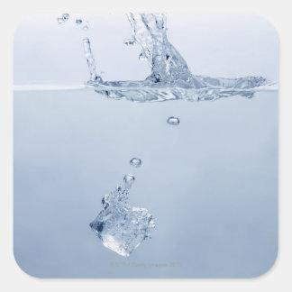Ice cube splashing into water square sticker
