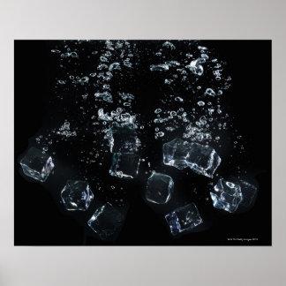 Ice cubes splashing in water poster