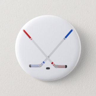 Ice hockey sticks and puck 2 inch round button