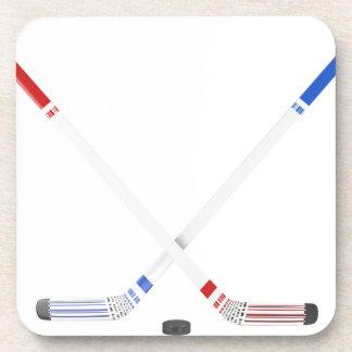 Ice hockey sticks and puck coaster