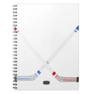 Ice hockey sticks and puck notebook