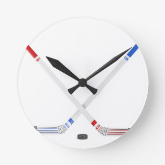 Ice hockey sticks and puck round clock
