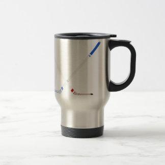 Ice hockey sticks and puck travel mug