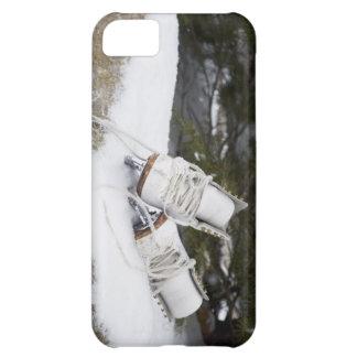 Ice skates, figure skates In snow iPhone 5C Covers