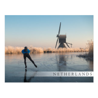 Ice skating past windmill and reeds bar postcard