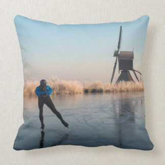 Ice skating past windmill and reeds pillow