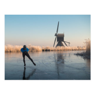 Ice skating past windmill and reeds postcard
