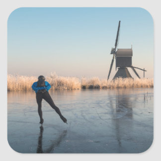 Ice skating past windmill and reeds sticker