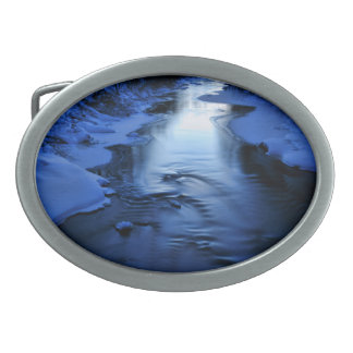Icy river on cold winter evening oval belt buckle