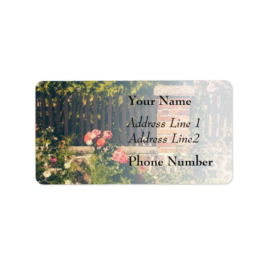 Idyllic Garden With Roses, Wooden Fence Label