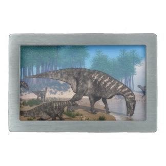 Iguanodon dinosaurs herd at the shoreline belt buckles