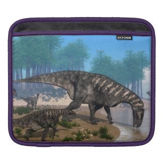Iguanodon dinosaurs herd at the shoreline iPad sleeve