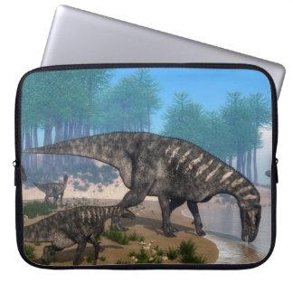 Iguanodon dinosaurs herd at the shoreline laptop sleeve