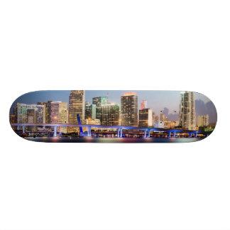 Illuminated skyline of downtown Miami at dusk Skateboard Decks