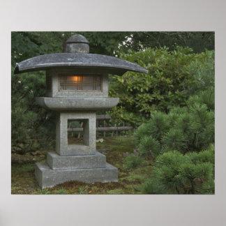 Illuminated stone lantern in Japanese Garden Poster