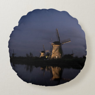 Illuminated windmill at Blue Hour round pillow