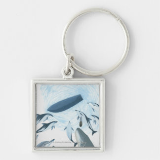 Illustration of dolphins looking up at a boat Silver-Colored square keychain