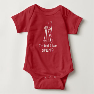 I'm Told I Love Skiing (white graphic) Baby Bodysuit