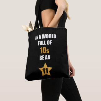 In a world full of tens, be an eleven. Cute Saying Tote Bag