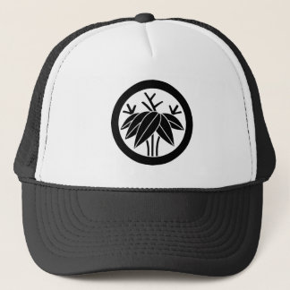In circle root bamboo grass trucker hat