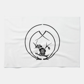 In holding breaking pine needle branch plum kitchen towel