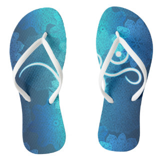 Indian ornament pattern with ohm symbol flip flops