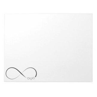 Infinity heart symbol notepad