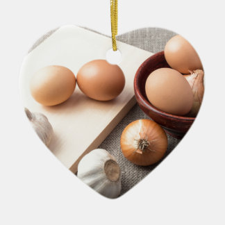 Ingredients for cooking in retro style ceramic heart ornament