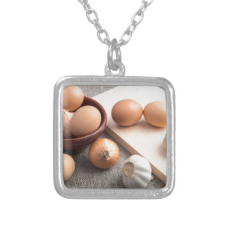 Ingredients for cooking in retro style silver plated necklace
