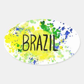 Inscription Brazil on background watercolor stains Oval Sticker