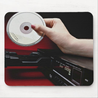 Inserting CD into CD player Mouse Pad