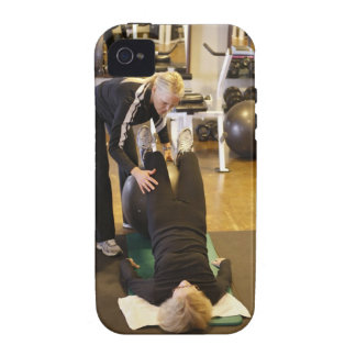 Instructor helps senior client with stretches iPhone 4/4S cases