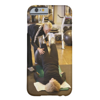 Instructor helps senior client with stretches barely there iPhone 6 case