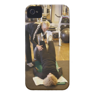 Instructor helps senior client with stretches iPhone 4 cases